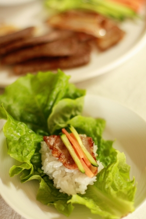 Korean food, Yakiniku and rice on lettuce photo