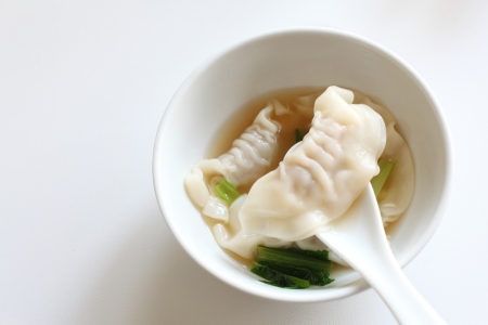 copy sapce: chinese food,  Jiaozi dim sum with soup