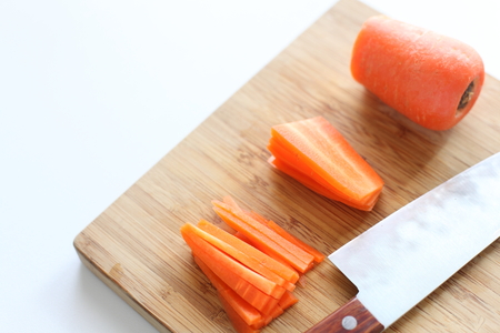 chopped carrot on wooden cutting board