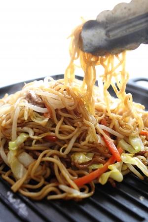 yakisoba: Japanese cooking, fried noodles Yakisoba on pan Stock Photo
