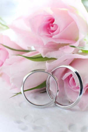 pink roses and wedding rings