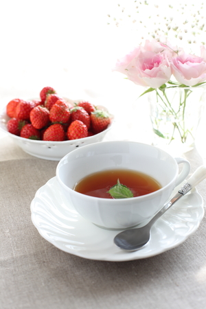 herbal tea and strawberry for life style image photo