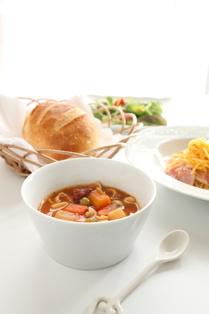 minestrone: homemade minestrone and french bread Stock Photo