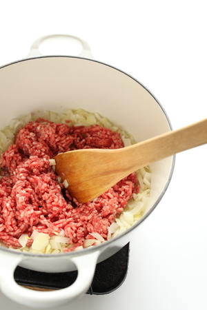 сooking: tomato and mince in pot