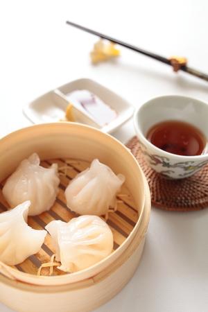 cha: Chinese food, shrimp dumpling and tea for yum cha image Stock Photo