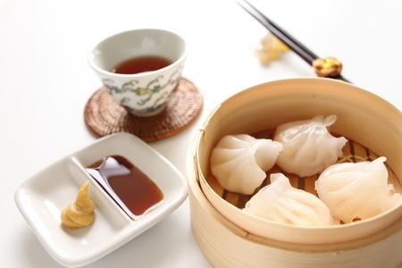 Chinese food, shrimp dumpling and tea for yum cha image photo