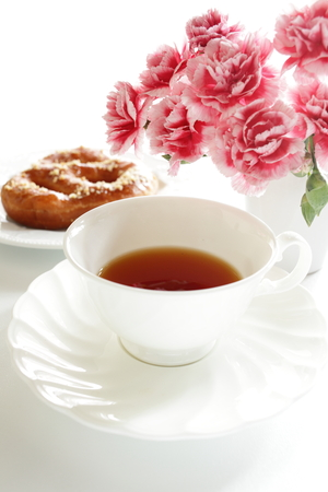 Black tea and confectionery for afternoon tea image photo