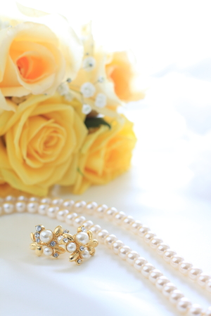 ear rings: yellow roses bouquet with pearl necklace and ear rings