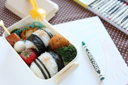 kids food: Japanese bento, kids food with crayon on background for picnic image Stock Photo