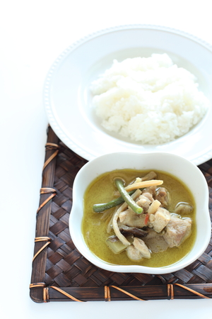 Thai cuisine, green chicken curry with rice photo
