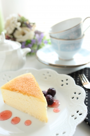 Cheese cake and berry sauce photo