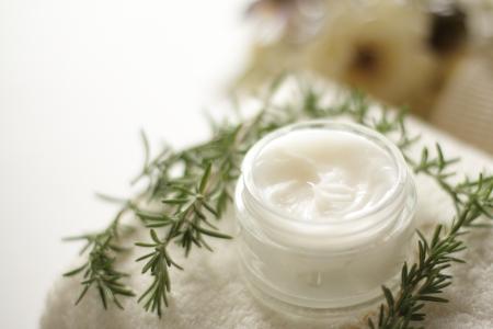 facial cream and rosemary on towel beauty image Stock Photo