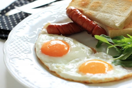 sunny side up: sunny side up and sausage with toast Stock Photo
