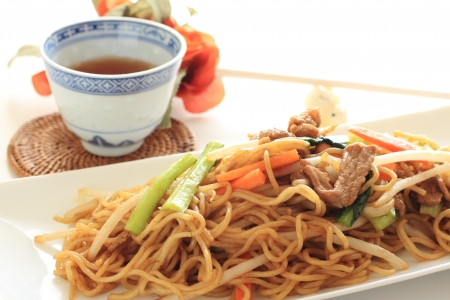 chinese noodles: Chinese fried noodles and tea Stock Photo