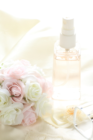 bottle of spray and flower for facial cosmetic image 写真素材