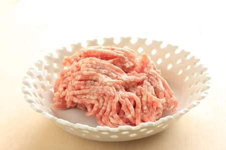 freshness mince pork on white background with copy space