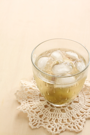 Japanese plum wine on rock photo