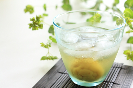 Japanese plum wine on rock