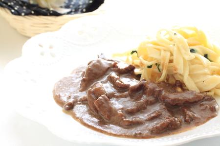 Russian food, stroganoff beef with fettuccine pasta