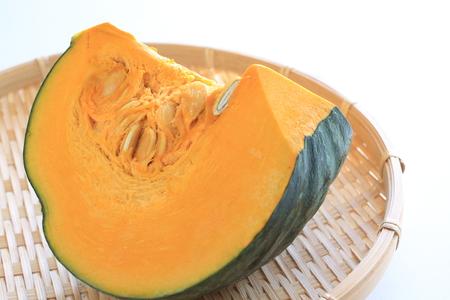 Japanese pumpkin chopped on bamboo basket photo