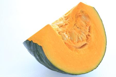 Japanese pumpkin chopped on white background photo