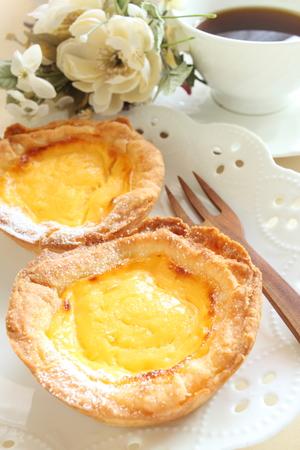 egg tart: Egg tart and coffee Stock Photo