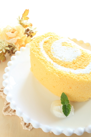 swiss roll: piece fo swiss roll on dish served with mint