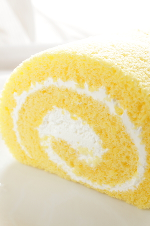 swiss roll: Swiss roll on white plate