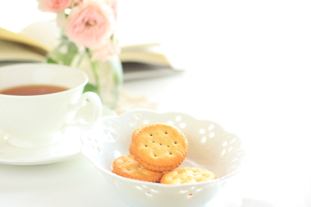 life style: biscuit and tea with book on background for life style image Stock Photo
