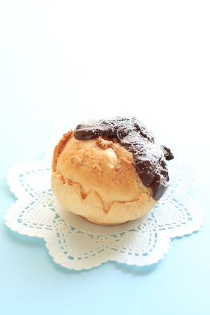 coating: Home bakery, puff cream with chocolate coating Stock Photo
