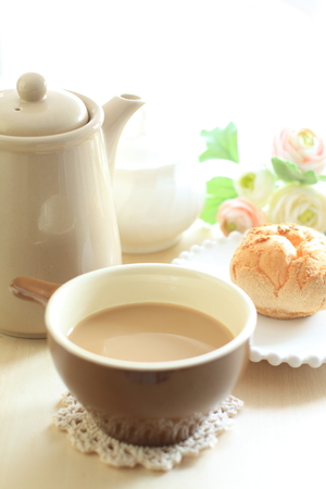 cafe latte: Cafe latte and dessert puff cream Stock Photo