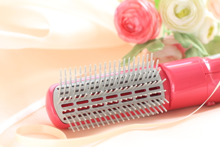 Hair dryer and artificial flower