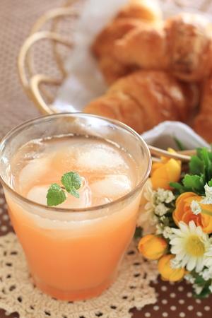 grapefruit juice: iced pink grapefruit juice and croissant