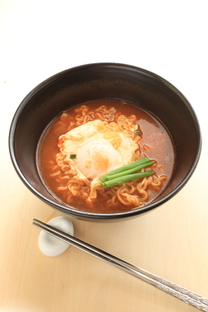 poach: Korean food poached on spicy noodles