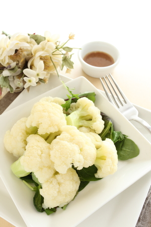 food dressing: Boiled cauliflower served with dressing for healthy food image Stock Photo