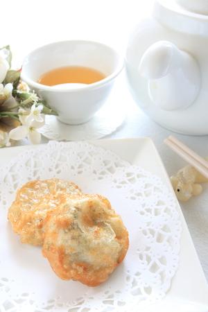 leek: Leek Jiaozi and tea Stock Photo