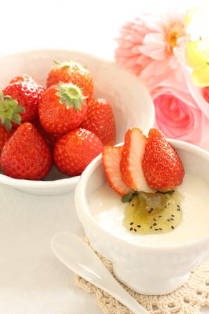 sweet food: strawberry and Kiwi fruit on Almond Tofu for Chinese dessert image