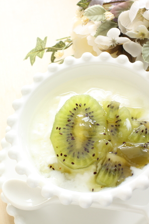 Homemade kiwi fruit and jam on yogurt photo