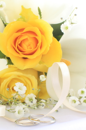 jewellry: yellow rose and wedding ring