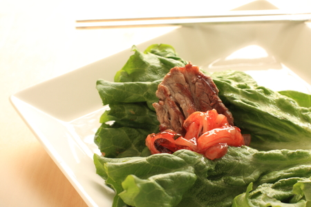 Korean cuisine grilled marble beef on lettuce photo