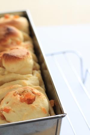 obody: Homemade orange bun on mold Stock Photo