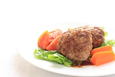 hamburger steak: homemade hamburger steak served with tomato Stock Photo