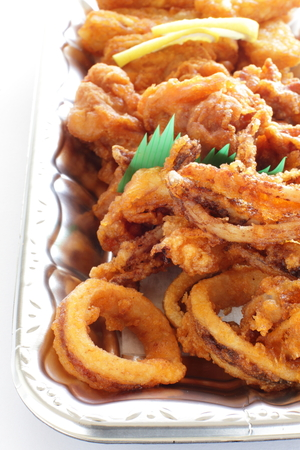party with food: deep fried of squid right and chicken for party food image