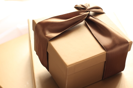 golden gift box and brown ribbon