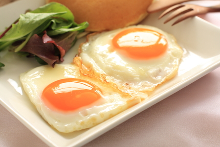 sunny side up: Homemade sunny side up fried egg for gourmet breakfast image