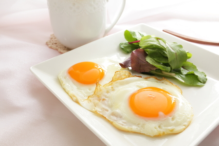 Sunny side up and salad Stock Photo