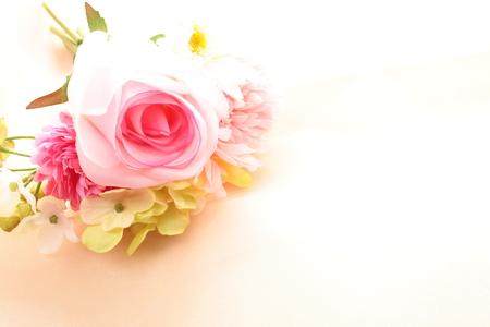 artificial flower: Artificial flower on satin Stock Photo