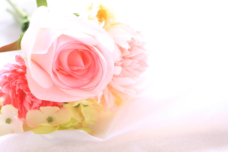 artificial flower: artificial flower on satin fabric Stock Photo