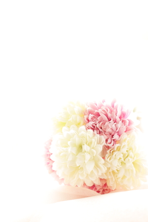 pink satin: artificial flower on pink satin fabric Stock Photo