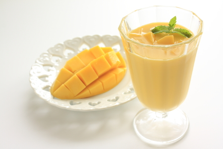 Tropical fruit, Mango smoothie in the mixer
